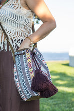 Boho Chic drawstring bag with brown tassels and geometric patterns