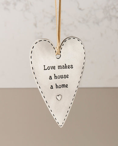 מתלה   Love makes a house a home