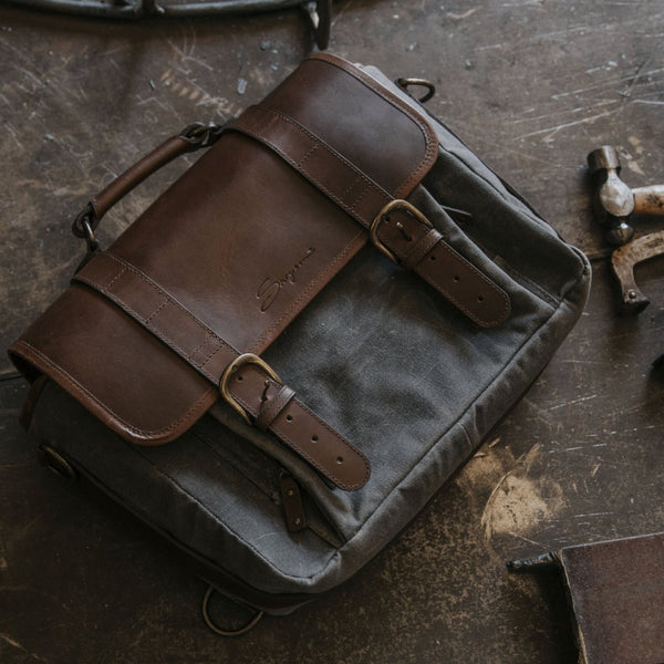 Everyday Carry Laptop Messenger Bag Charcoal on workbench