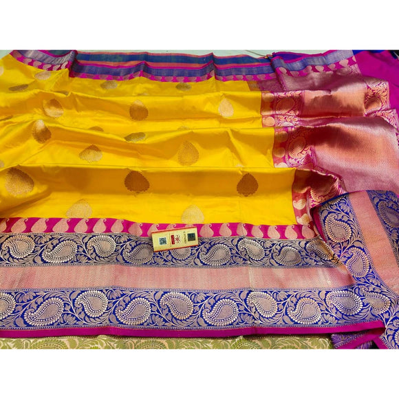 Bright yellow colored pure katan silk party wear Banarasi weave saree with silk mark