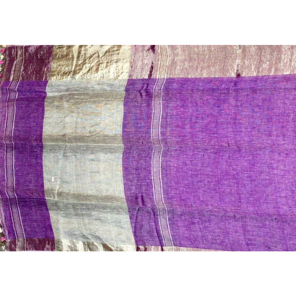 Light purple colored Plain body pure linen Saree with small and big zari borders
