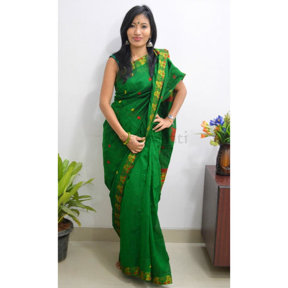Assam cotton handwoven saree in classy bottle green