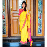 Bright yellow linen saree with beautiful contrast pink border