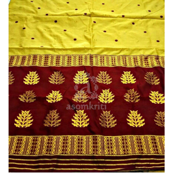 Assam cotton handwoven saree in yellow with maroon pallu