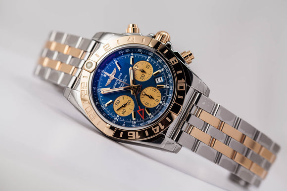 Factory refurbished Breitling Chronomat 44 GMT 18kt gold/SS Blue Dial with Extra Strap/Buckle - The Luxury Well