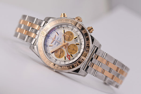 Breitling Chronomat 44 GMT 18kt gold/SS Silver Dial - The Luxury Well