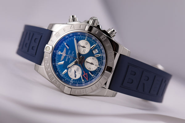 Breitling Chronomat 44 GMT Blue Dial on blue Diver Pro III - The Luxury Well