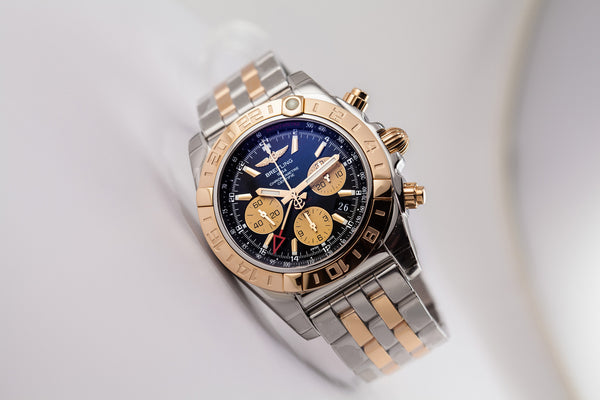 Breitling Chronomat 44 GMT 18kt Gold/SS Black Dial - The Luxury Well