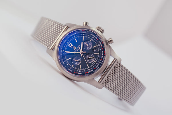 Breitling Transocean Unitime Pilot Worldtimer Chronograph Blue Dial - The Luxury Well