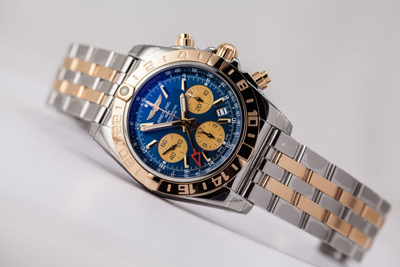 Breitling Chronomat 44 GMT 18kt gold/SS Blue Dial - The Luxury Well