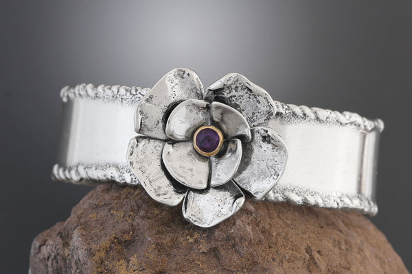 Wide Sterling Silver Cuff Bracelet with a Double Dogwood Flower and Amethyst in Gold Bezel
