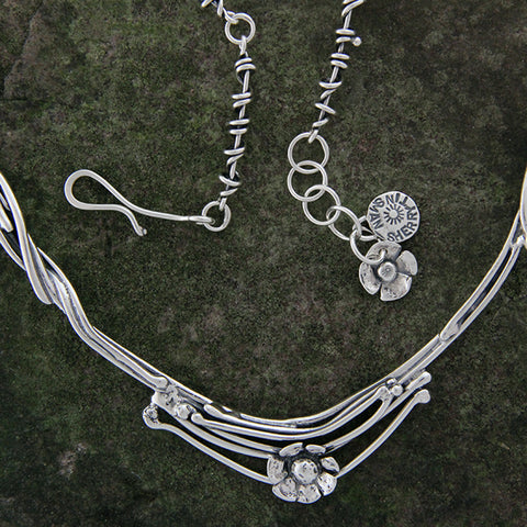 Sterling Silver Vine Neck Ring with Daisy Flower