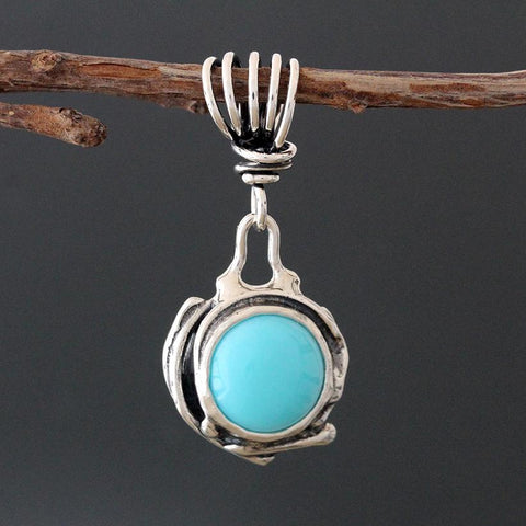 Sterling Silver and Turquoise Pendant with Vine Bail