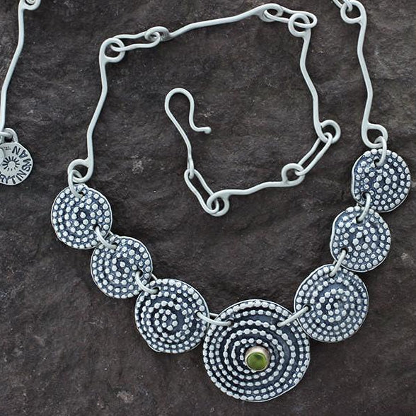 Sterling Silver Beaded Spiral Necklace with Peridot in Gold Bezel Center