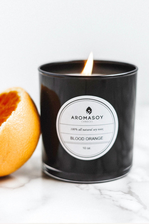Aromatherapy soy candle in Blood Orange scent. All natural soy based container candle has a fresh citrus aroma with green undertones