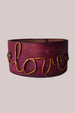 Hand dyed leather bracelet with message of love written in copper.
