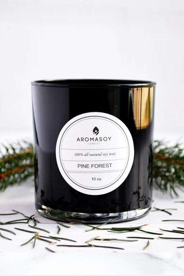 All natural hand crafted soy container with pine needles for a fresh christmas tree scent. Hand poured in a black glass votive. Perfect for gift giving.