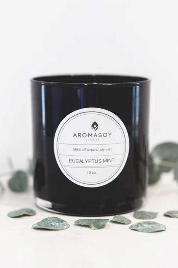 All natural soy container candle with eucalyptus leaves. Black glass votive candle with floral and citrus scent.