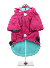 Protect your pup from the rain with this waterproof fleece-lined raincoat in vivid Fuschia
