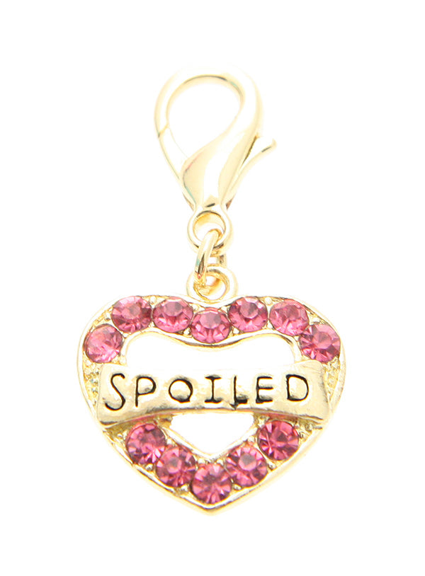This is a beautiful gold and pink heart shaped dog collar charm with the words spoiled written on it
