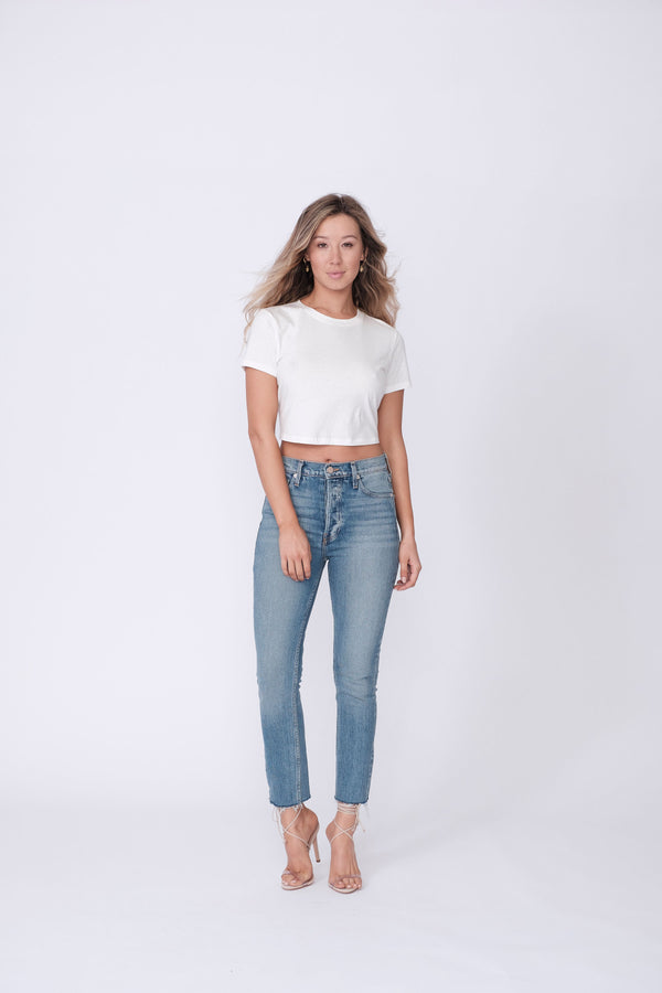 "Front View of Midheaven's High-Rise Vintage Wash Button Fly Skinny w/ Raw Hem    Details: Model is 5' 7"" and is wearing 4"" heels. Rise: 10 3/4"" Inseam: 28"" Leg Opening: 10.5"" Fabric contents: 98% Cotton - 2% Elastane"