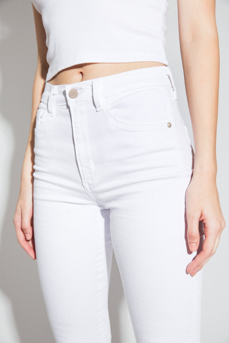 "Front View Up Close of Midheaven's Mid-Rise White Flare w/ Raw Hem     Details: Model is 5'8"" and is wearing 4"" heels. Rise: 9.75"" Inseam: 33"" Leg Opening: 21"" Fabric contents: 98% Cotton - 2% Elastane NOTE: Fabric will stretch with wear. Consider sizing down."