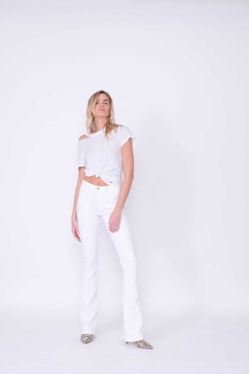 "Front View of Midheaven's Mid-Rise White Flare     Details: Model is 6' and is wearing 4"" heels. Rise: 9.75"" Inseam: 38"" Leg Opening: 21"" Fabric contents: 98% Cotton - 2% Elastane NOTE: Fabric will stretch with wear. Consider sizing down."