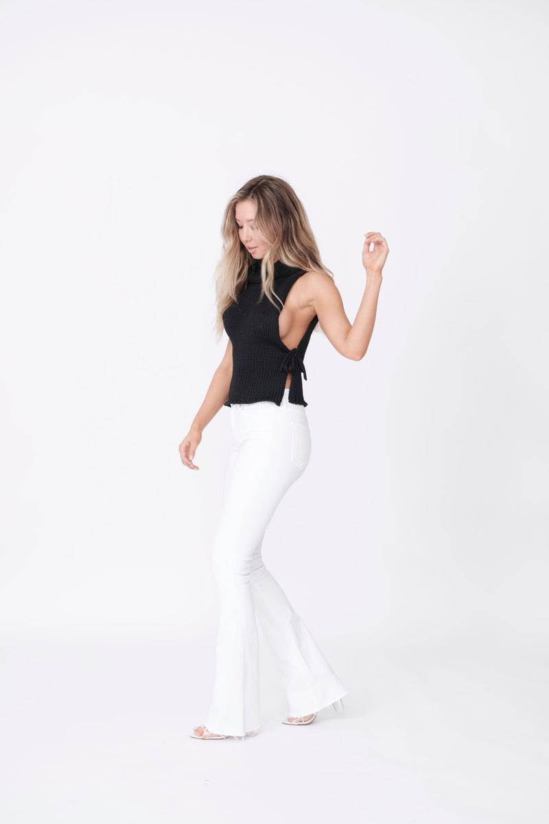 "Side View of Midheaven's Mid-Rise White Flare w/ Raw Hem     Details: Model is 5'8"" and is wearing 4"" heels. Rise: 9.75"" Inseam: 33"" Leg Opening: 21"" Fabric contents: 98% Cotton - 2% Elastane NOTE: Fabric will stretch with wear. Consider sizing down."