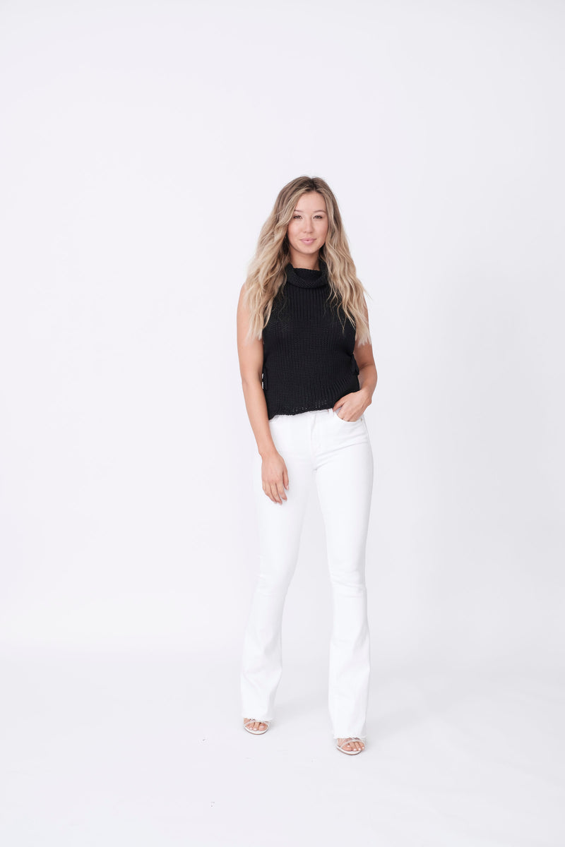 "Front View of Midheaven's Mid-Rise White Flare w/ Raw Hem     Details: Model is 5'8"" and is wearing 4"" heels. Rise: 9.75"" Inseam: 33"" Leg Opening: 21"" Fabric contents: 98% Cotton - 2% Elastane NOTE: Fabric will stretch with wear. Consider sizing down."