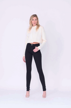 "Front View of Midheaven's High-Rise Split Hem Skinny  Details: Model is 6' and is wearing 4"" heels. Rise: 10"" Inseam: 36"" Leg Opening: 10"" Fabric contents: 98% Cotton - 2% Elastane"
