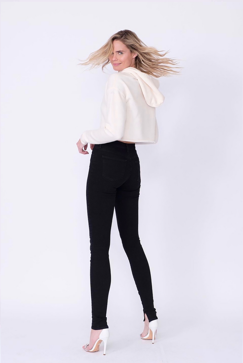 "Back View of Midheaven's High-Rise Split Hem Skinny  Details: Model is 6' and is wearing 4"" heels. Rise: 10"" Inseam: 36"" Leg Opening: 10"" Fabric contents: 98% Cotton - 2% Elastane"
