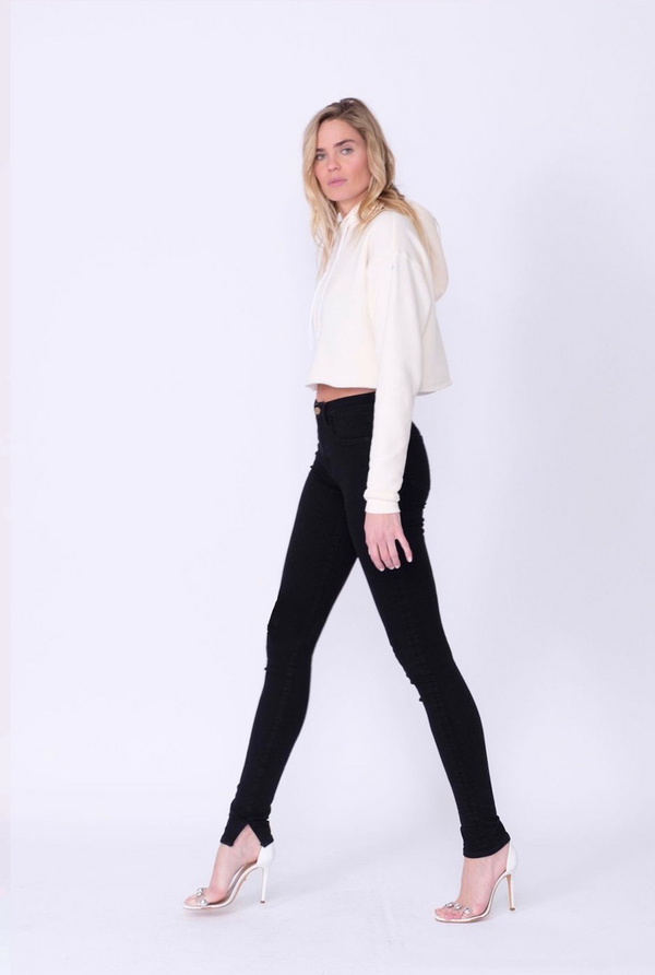 "Side View of Midheaven's High-Rise Split Hem Skinny  Details: Model is 6' and is wearing 4"" heels. Rise: 10"" Inseam: 36"" Leg Opening: 10"" Fabric contents: 98% Cotton - 2% Elastane"