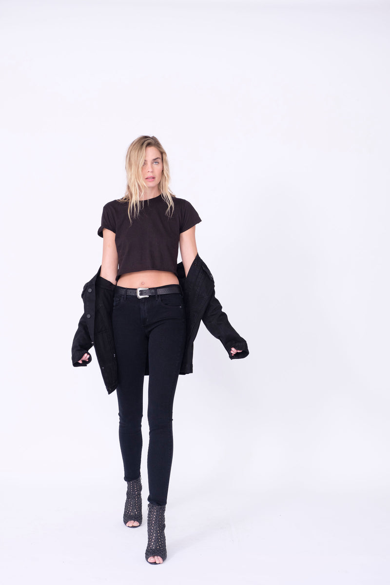 "Front View of Midheaven's Mid-Rise Black Skinny  Details: Model is 6' and is wearing 4"" heels. Rise: 9"" Inseam: 33"" Leg Opening: 10.5"" Fabric contents: 98%Cotton - 2%Elastane     Note: We suggest sizing up. The Astrid runs small."