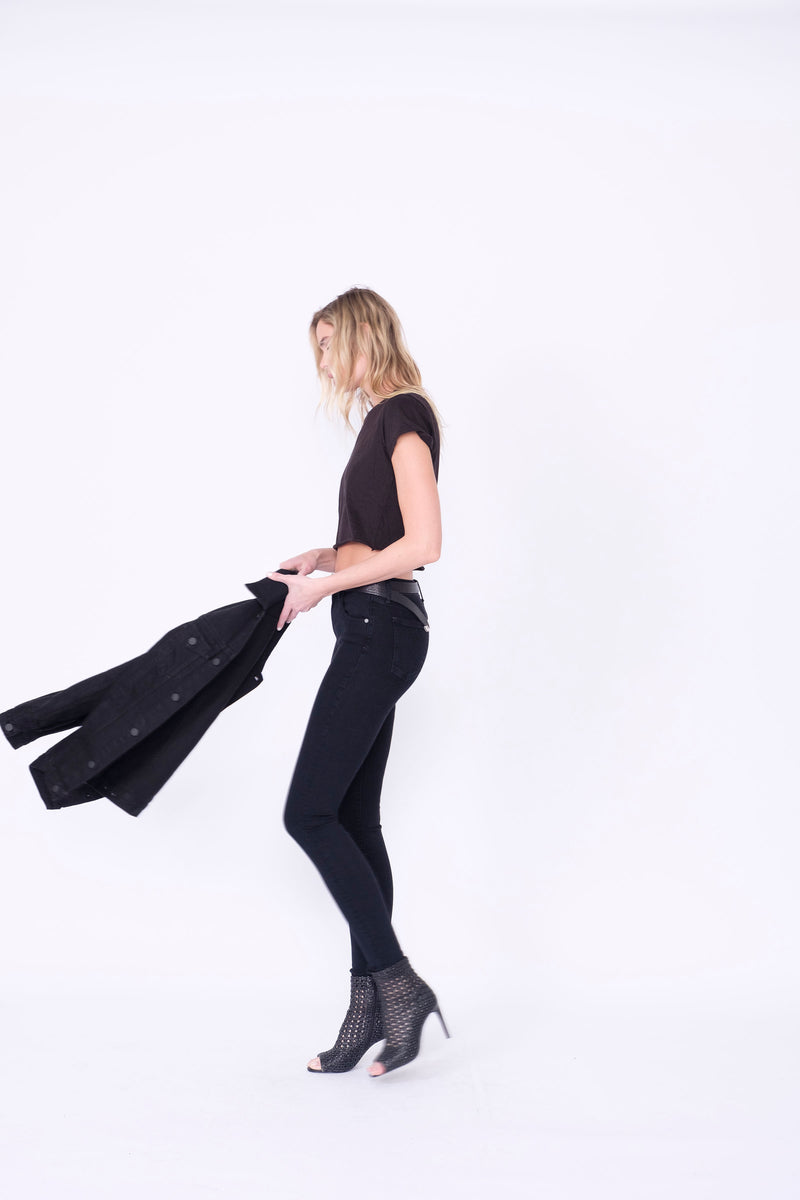 "Side View of Midheaven's Mid-Rise Black Skinny  Details: Model is 6' and is wearing 4"" heels. Rise: 9"" Inseam: 33"" Leg Opening: 10.5"" Fabric contents: 98%Cotton - 2%Elastane     Note: We suggest sizing up. The Astrid runs small."