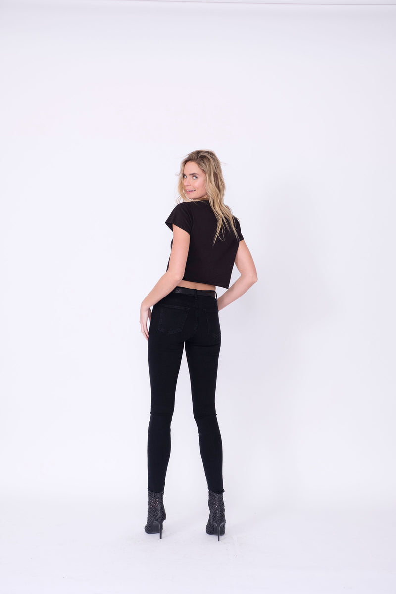 "Back View of Midheaven's Mid-Rise Black Skinny  Details: Model is 5'10"" and is wearing 4"" heels. Rise: 9"" Inseam: 33"" Leg Opening: 10.5"" Fabric contents: 98%Cotton - 2%Elastane     Note: We suggest sizing up. The Astrid runs small."