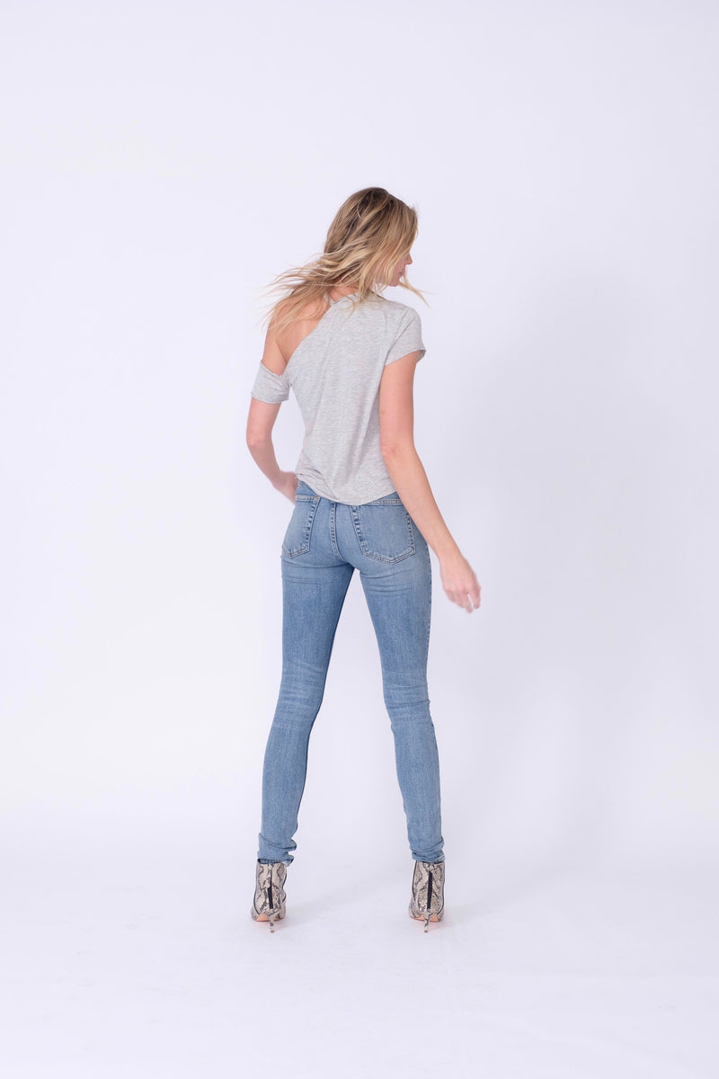 "Back View of Midheaven's High-Rise Vintage Wash Button Fly Skinny  FABRIC WILL STRETCH A BIT, CONSIDER SIZING DOWN   Details: Model is 6' and is wearing 4"" heels. Rise: 10 3/4"" Inseam: 33"" Leg Opening: 10.5"" Fabric contents: 98% Cotton - 2% Elastane"