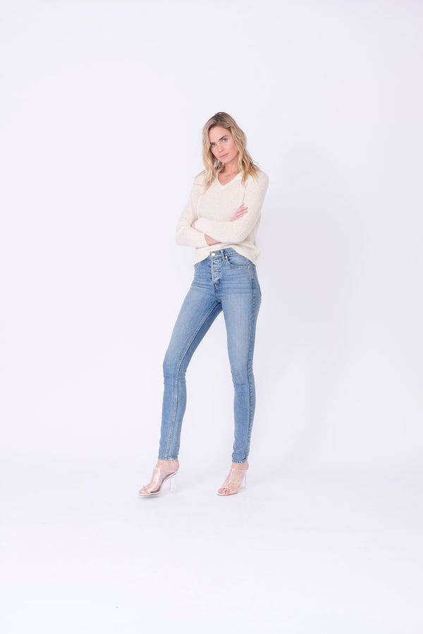 "Front View of Midheaven's High-Rise Vintage Wash Button Fly Skinny  FABRIC WILL STRETCH A BIT, CONSIDER SIZING DOWN   Details: Model is 6' and is wearing 4"" heels. Rise: 10 3/4"" Inseam: 33"" Leg Opening: 10.5"" Fabric contents: 98% Cotton - 2% Elastane"