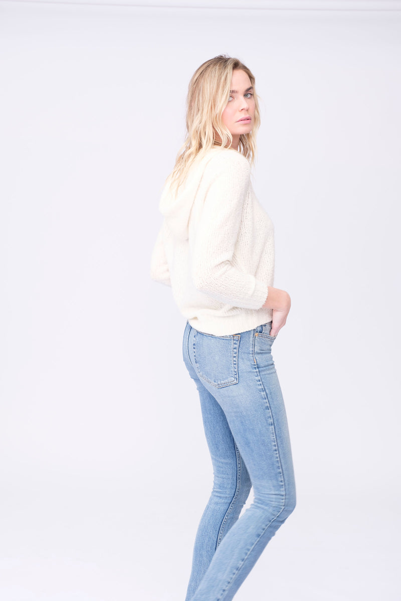 "Side View of Midheaven's High-Rise Vintage Wash Button Fly Skinny  FABRIC WILL STRETCH A BIT, CONSIDER SIZING DOWN   Details: Model is 6' and is wearing 4"" heels. Rise: 10 3/4"" Inseam: 33"" Leg Opening: 10.5"" Fabric contents: 98% Cotton - 2% Elastane"