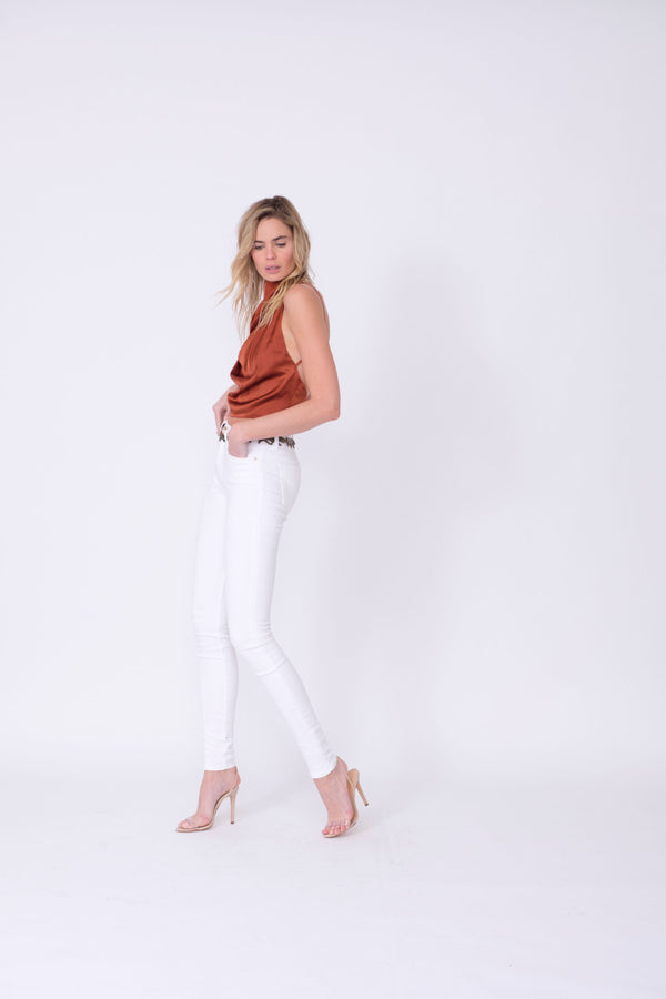"Side View of Midheaven's Mid-Rise White Skinny     Details: Model is 6' and is wearing 4"" heels. Rise: 9.75"" Inseam: 34"" Leg Opening: 10"" Fabric contents: 98% Cotton - 2% Elastane"