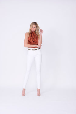 "Front View of Midheaven's Mid-Rise White Skinny     Details: Model is 6' and is wearing 4"" heels. Rise: 9.75"" Inseam: 34"" Leg Opening: 10"" Fabric contents: 98% Cotton - 2% Elastane"