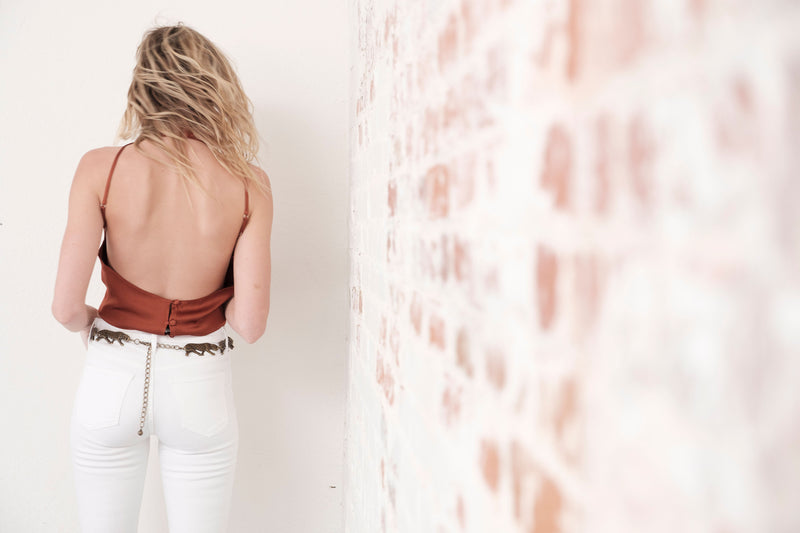 "Editorial Shot: Back View of Midheaven's Mid-Rise White Skinny     Details: Model is 6' and is wearing 4"" heels. Rise: 9.75"" Inseam: 34"" Leg Opening: 10"" Fabric contents: 98% Cotton - 2% Elastane"