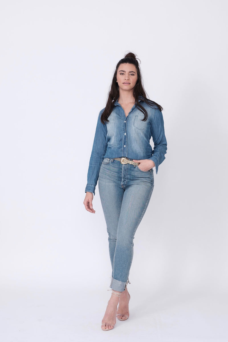 "Front View of Midheaven's High-Rise Vintage Wash Button Fly Skinny w/ Raw Hem    Details: Model is 5' 9"" and is wearing 4"" heels. Rise: 10 3/4"" Inseam: 28"" Leg Opening: 10.5"" Fabric contents: 98% Cotton - 2% Elastane"