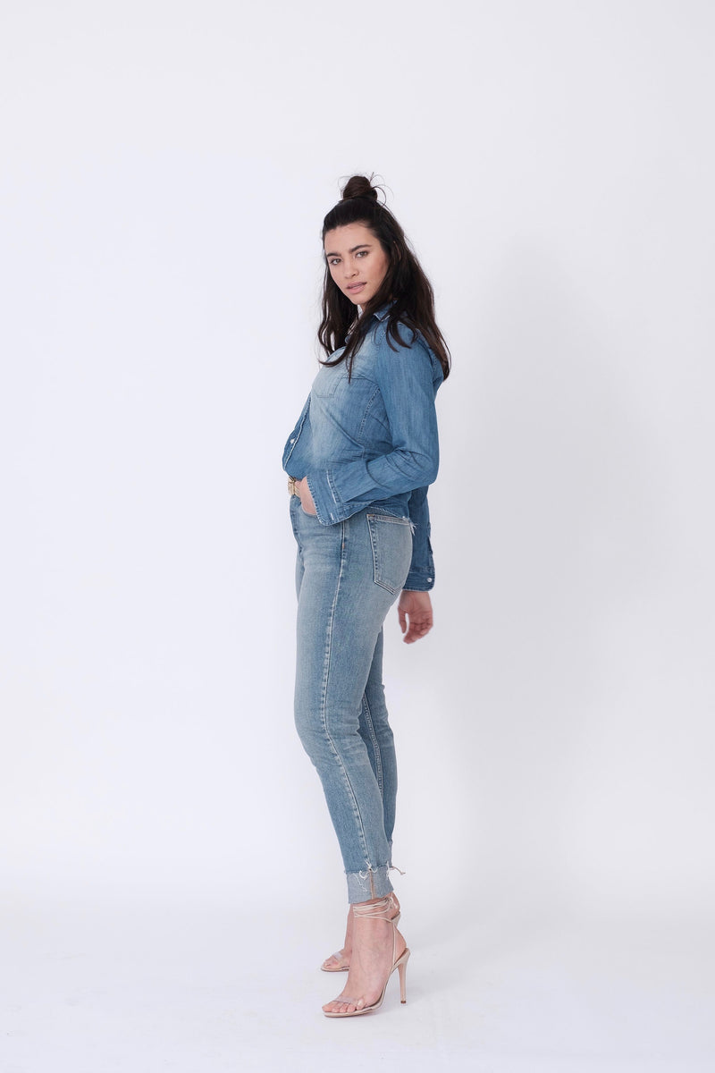"Side View of Midheaven's High-Rise Vintage Wash Button Fly Skinny w/ Raw Hem    Details: Model is 5' 9"" and is wearing 4"" heels. Rise: 10 3/4"" Inseam: 28"" Leg Opening: 10.5"" Fabric contents: 98% Cotton - 2% Elastane"