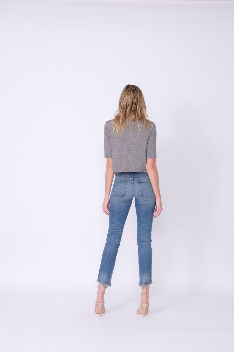 "Back View of Midheaven's Relaxed High-Rise Straight Leg Details: Second Model: 6' - Wearing 4"" Heels Rigid denim will relax with wear. Considering going down one size.  Rise: 10""