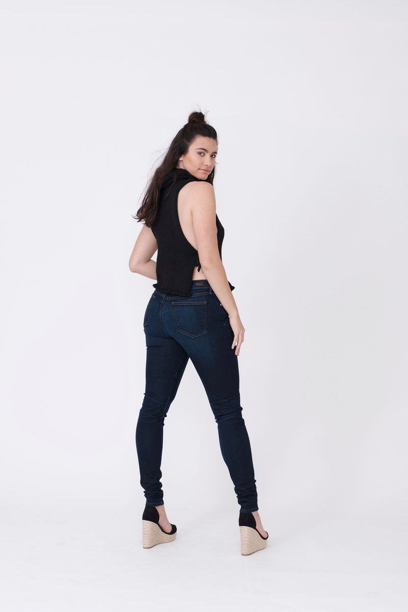 "Back View of Midheaven's Mid-Rise Indigo Skinny  ITEM RUNS SMALL, CONSIDER SIZING UP ONE SIZE  Details: Model is 5'10"" and is wearing 4"" heels. Rise: 9"" Inseam: 33"" Leg Opening: 10.5"" Fabric contents: 98%Cotton - 2%Elastane"