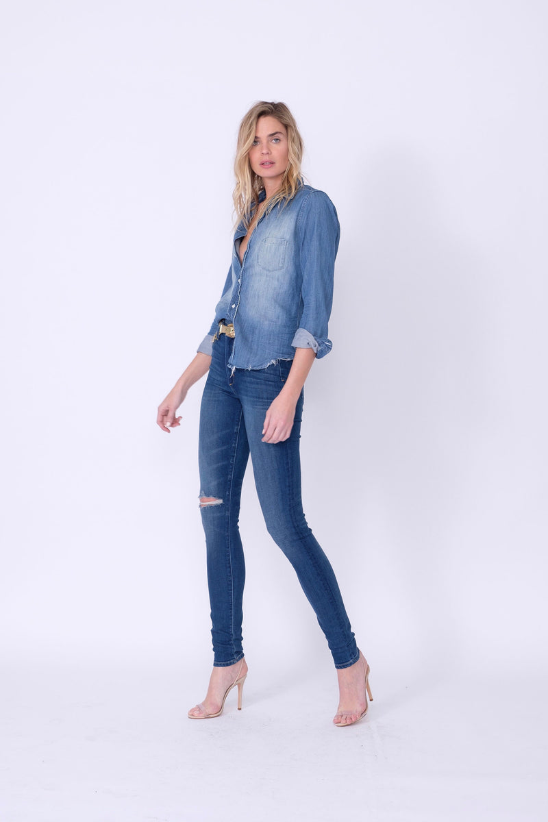 "Side View of Midheaven's High-Rise Indigo Skinny    Details: Model is 6' and is wearing 4"" heels. Rise: 10"" Inseam: 35.5"" Leg Opening: 9.5"" Fabric contents: 98%Cotton - 2%Elastane"
