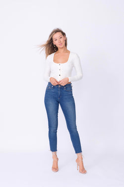"Front View of Midheaven's High-Rise Indigo Skinny w/ Raw Hem    Details: Model is 5'7 and is wearing 4"" heels. Rise: 10"" Inseam: 28"" Leg Opening: 9.5"" Fabric contents: 98%Cotton - 2%Elastane"