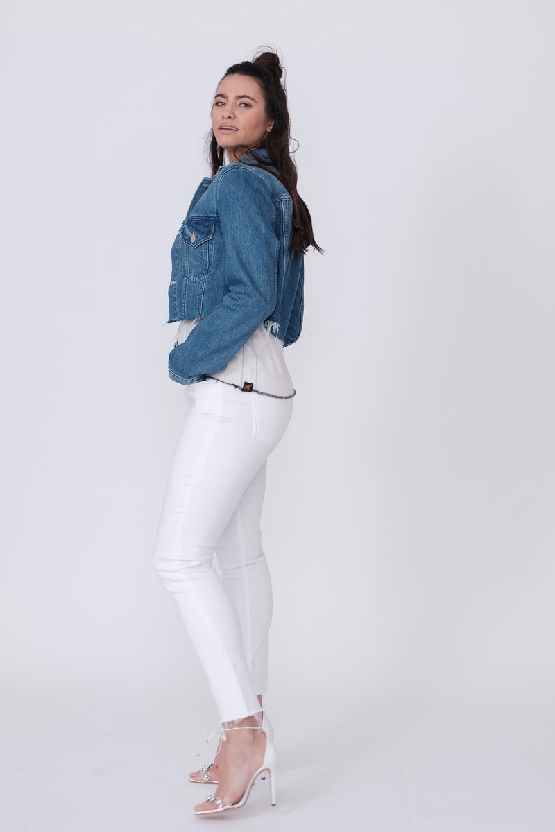"Side View of Midheaven's Mid-Rise White Skinny w/ Raw Hem     Details: Model is 5'10"" and is wearing 4"" heels. Rise: 9.75"" Inseam: 29"" Leg Opening: 10"" Fabric contents: 98% Cotton - 2% Elastane"
