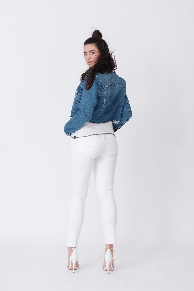 "Back View of Midheaven's Mid-Rise White Skinny w/ Raw Hem     Details: Model is 5'10"" and is wearing 4"" heels. Rise: 9.75"" Inseam: 29"" Leg Opening: 10"" Fabric contents: 98% Cotton - 2% Elastane"