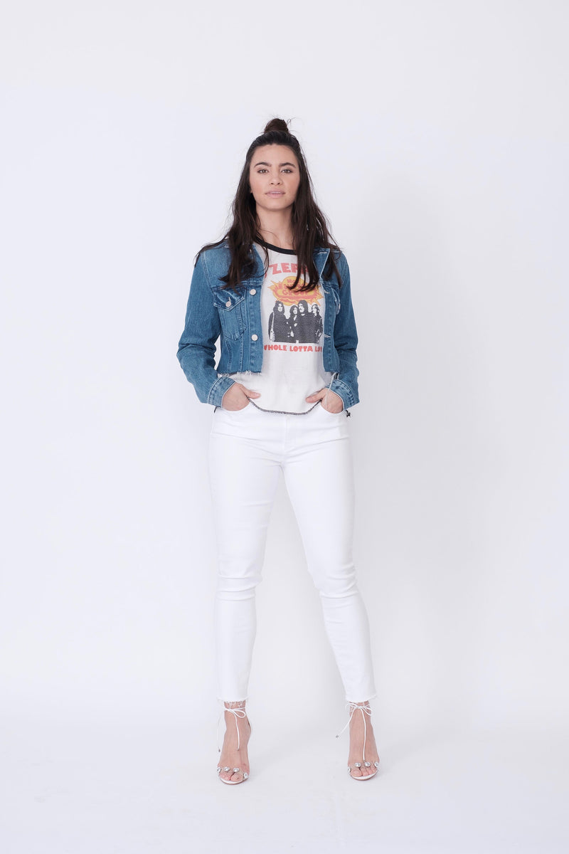 "Front View of Midheaven's Mid-Rise White Skinny w/ Raw Hem     Details: Model is 5'10"" and is wearing 4"" heels. Rise: 9.75"" Inseam: 29"" Leg Opening: 10"" Fabric contents: 98% Cotton - 2% Elastane"
